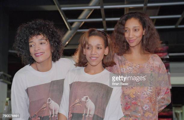 Joni Sledge Kim Sledge and Debbie Sledge of American vocal group Sister Sledge pictured together at an instore appearance at the HMV record store in...