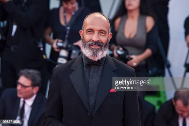 Jonis Bascir walks the red carpet ahead the Award Ceremony of the 74th Venice Film Festival at Sala Grande on September 9, 2017 in Venice, Italy.