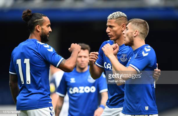 Jonjo Kenny of Everton celebrates with Theo Walcott and Richarlison after scoring the first goal of the game during the pre-season friendly match...