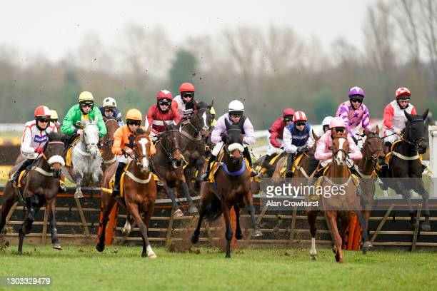 Jonjo O'Neill riding Soaring Glory take the first flight of hurdles before going on to win The Betfair Hurdle at Newbury Racecourse on February 21,...