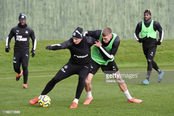Jonjo Shelvey controls the ball as Lewis Cass battles for the ball during the Newcastle United Training Session at the Newcastle United Training...