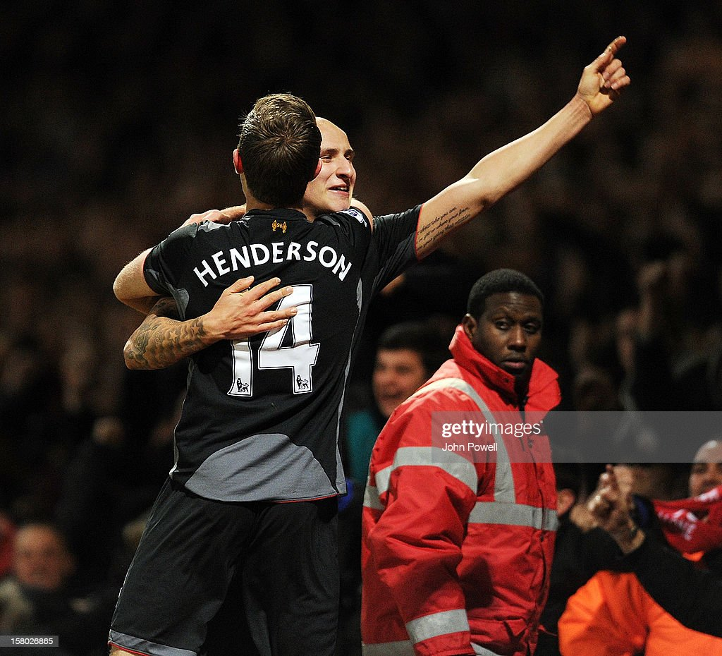 Jonjo Shelvey (R) of Liverpool celebrates with team-mate Jordan Henderson after James Collins of West Ham scored an own goal during the Barclays Premier League match between West Ham United and Liverpool at Boleyn Ground on December 9, 2012 in London, England.