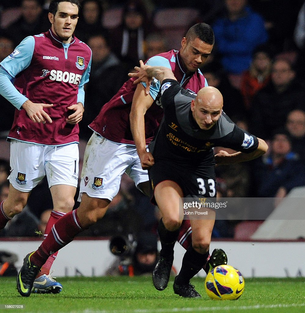 Jonjo Shelvey of Liverpool competes with Winston Reid of West Ham United during the Barclays Premier League match between West Ham United and Liverpool at Boleyn Ground on December 9, 2012 in London, England.