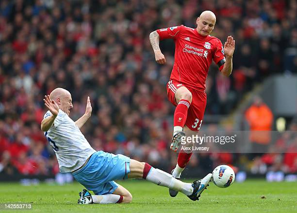 Jonjo Shelvey of Liverpool is tackled by James Collins of Aston Villa during the Barclays Premier League match between Liverpool and Aston Villa at...