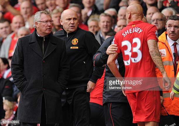 Jonjo Shelvey of Liverpool screams abuse at Sir Alex Ferguson the head coach / manager of Manchester United after being sent off