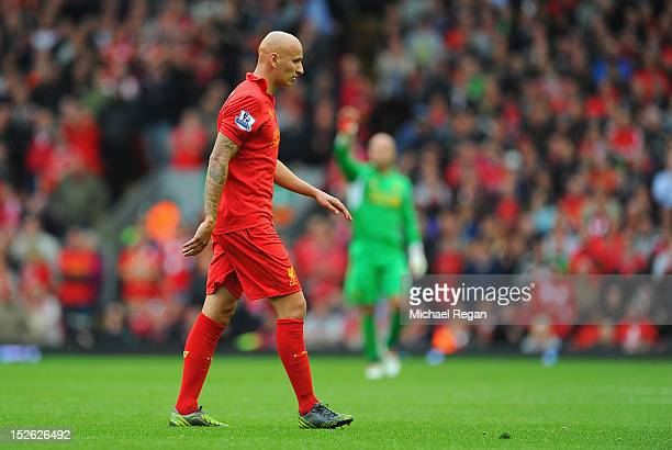 Jonjo Shelvey of Liverpool walks off the pitch after being sent off during the Barclays Premier League match between Liverpool and Manchester United...