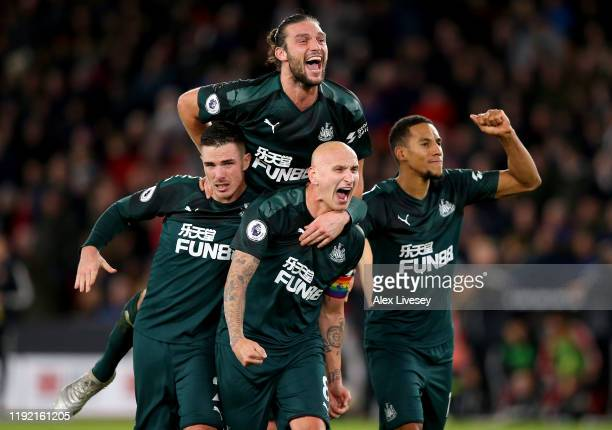 Jonjo Shelvey of Newcastle celebrate with his team mates after he scores the 2nd goal during the Premier League match between Sheffield United and...