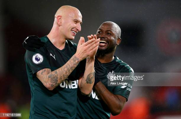 Jonjo Shelvey of Newcastle celebrate with team mate Jetro Willems after the Premier League match between Sheffield United and Newcastle United at...