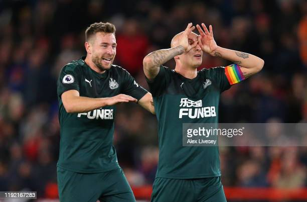 Jonjo Shelvey of Newcastle celebrate with team mate Paul Dummett during the Premier League match between Sheffield United and Newcastle United at...