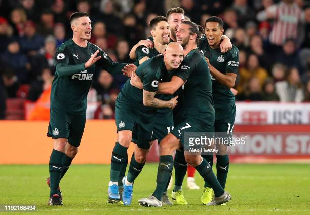 Jonjo Shelvey of Newcastle celebrates with his team mates after he scores the 2nd goal during the Premier League match between Sheffield United and...