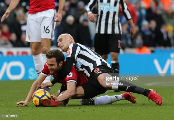 Jonjo Shelvey of Newcastle gets to grips with Juan Mata of Manchester United during the Premier League match between Newcastle United and Manchester...