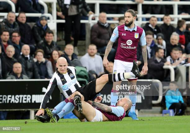 Jonjo Shelvey of Newcastle is tackled by Alan Hutton of Villa during the Sky Bet Championship match between Newcastle United and Aston Villa at St...