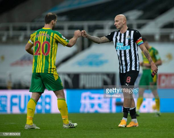 Jonjo Shelvey of Newcastle United and Branislav Ivanovic of West Bromwich Albion greet each other after the Premier League match between Newcastle...