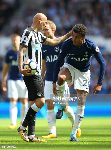 Jonjo Shelvey of Newcastle United and Dele Alli of Tottenham Hotspur argue after a challenge during the Premier League match between Newcastle United...