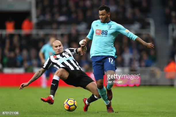 Jonjo Shelvey of Newcastle United and Joshua King of AFC Bournemouth in action during the Premier League match between Newcastle United and AFC...