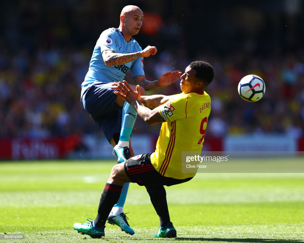 Jonjo Shelvey of Newcastle United and Troy Deeney of Watford clash during the Premier League match between Watford and Newcastle United at Vicarage Road on May 5, 2018 in Watford, England.