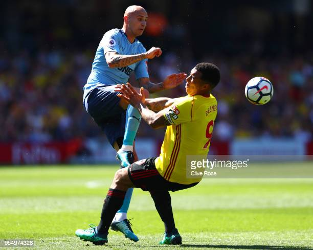 Jonjo Shelvey of Newcastle United and Troy Deeney of Watford clash during the Premier League match between Watford and Newcastle United at Vicarage...