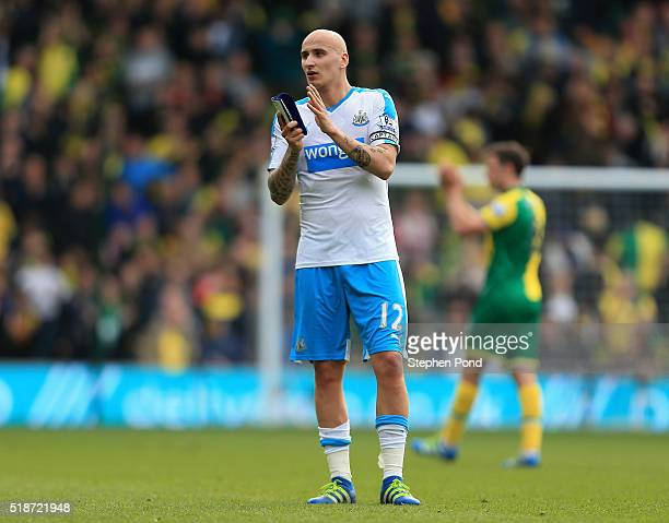 Jonjo Shelvey of Newcastle United applauds the away supporters after his team's 23 defeat in the Barclays Premier League match between Norwich City...