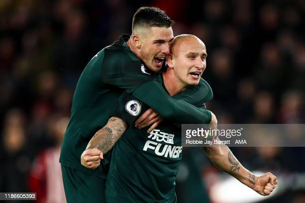Jonjo Shelvey of Newcastle United celebrates after scoring a goal to make it 02 which is allowed through VAR during the Premier League match between...