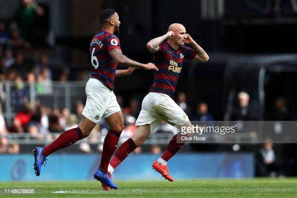 Jonjo Shelvey of Newcastle United celebrates after scoring his team's first goal during the Premier League match between Fulham FC and Newcastle...