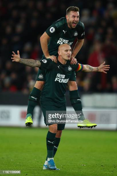 Jonjo Shelvey of Newcastle United celebrates scoring his side's second goal with team-mate Paul Dummett during the Premier League match between...