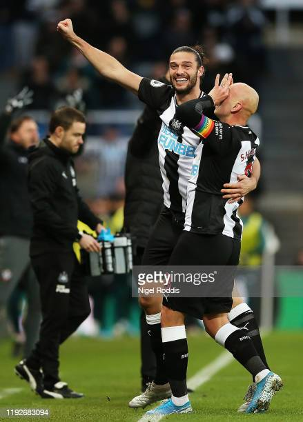 Jonjo Shelvey of Newcastle United celebrates with Andy Carroll after scoring his team's first goal during the Premier League match between Newcastle...