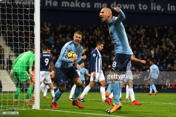 Jonjo Shelvey of Newcastle United celebrates with Florian Lejeune after the 2nd Newcastle goal during the Premier League match between West Bromwich...