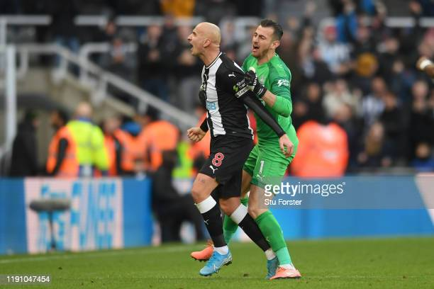 Jonjo Shelvey of Newcastle United celebrates with teammate Martin Dubravka after scoring his team's second goal during the Premier League match...