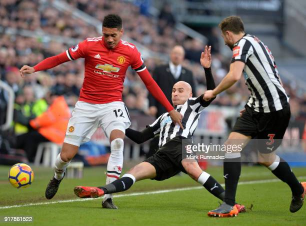 Jonjo Shelvey of Newcastle United challenges Chris Smalling of Manchester United for the ball during the Premier League match between Newcastle...
