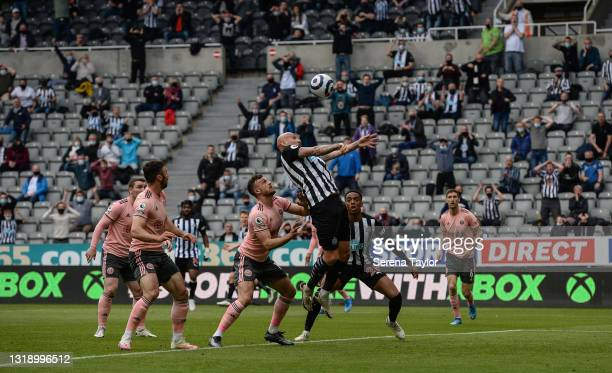 Jonjo Shelvey of Newcastle United FC heads the ball during the Premier League match between Newcastle United and Sheffield United at St. James Park...
