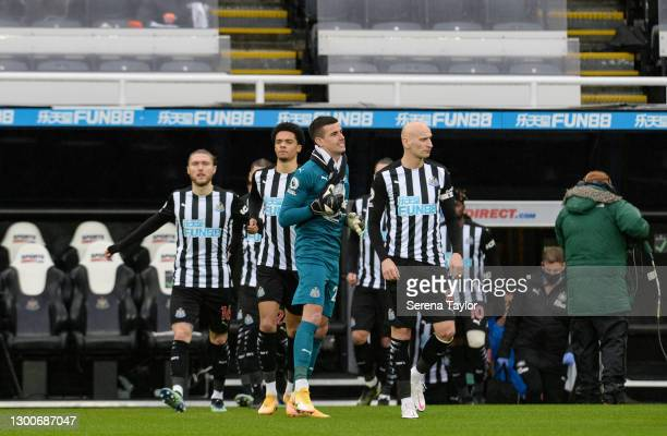 Jonjo Shelvey of Newcastle United FC walks outside with Goalkeeper Karl Darlow, Jamal Lewis and Jeff Hendrick during the Premier League match between...