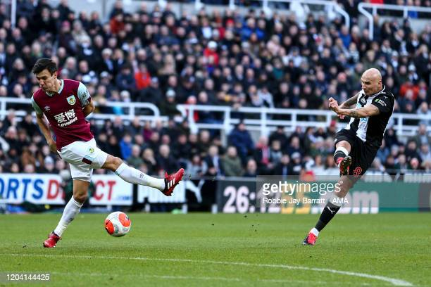 Jonjo Shelvey of Newcastle United has as shot blocked by Jack Cork of Burnley during the Premier League match between Newcastle United and Burnley FC...