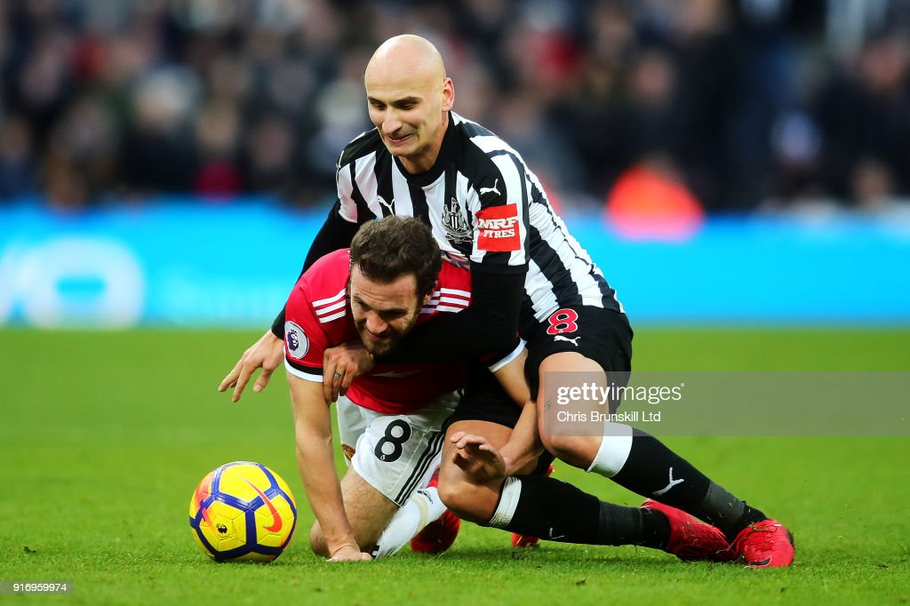 Jonjo Shelvey of Newcastle United in action with Juan Mata of Manchester United during the Premier League match between Newcastle United and Manchester United at St. James Park on February 11, 2018 in Newcastle upon Tyne, England.