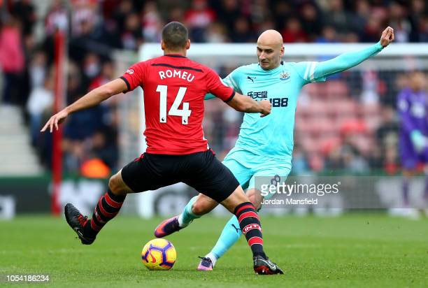 Jonjo Shelvey of Newcastle United is challenged by Oriol Romeu of Southampton during the Premier League match between Southampton FC and Newcastle...