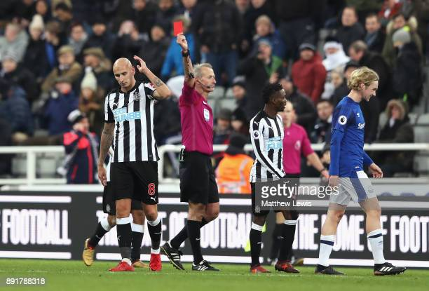 Jonjo Shelvey of Newcastle United is shown a red card by referee by Martin Atkinson during the Premier League match between Newcastle United and...