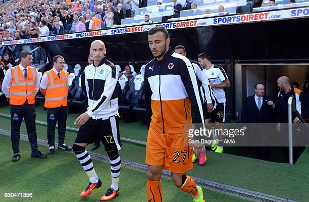 Jonjo Shelvey of Newcastle United looks at Romain Saiss of Wolverhampton Wanderers as they walk onto the pitch during the Sky Bet Championship match...