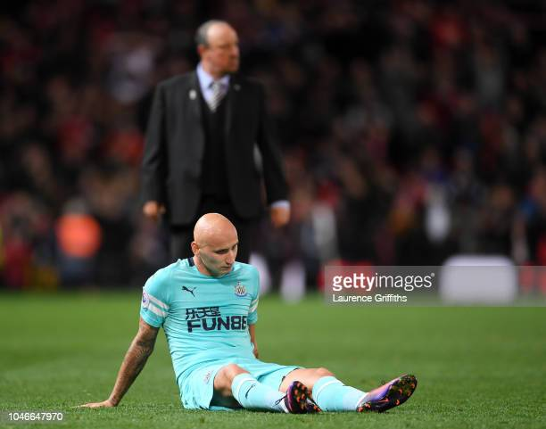 Jonjo Shelvey of Newcastle United looks dejected at full time after the Premier League match between Manchester United and Newcastle United at Old...