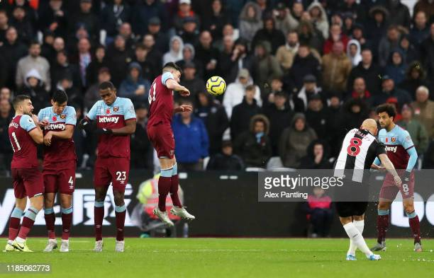 Jonjo Shelvey of Newcastle United scores his team's third goal during the Premier League match between West Ham United and Newcastle United at London...