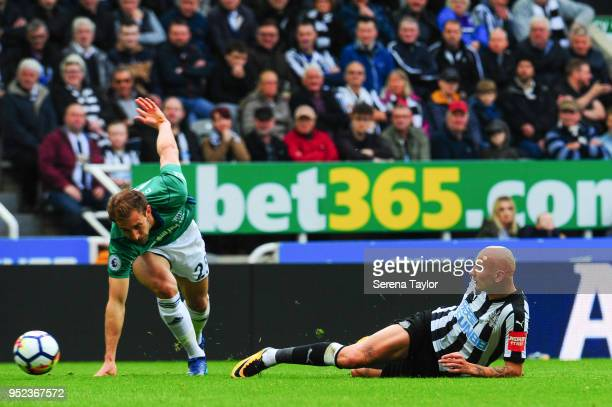 Jonjo Shelvey of Newcastle United slides in to win the ball from Craig Dawson of West Bromwich Albion during the Premier League match between...