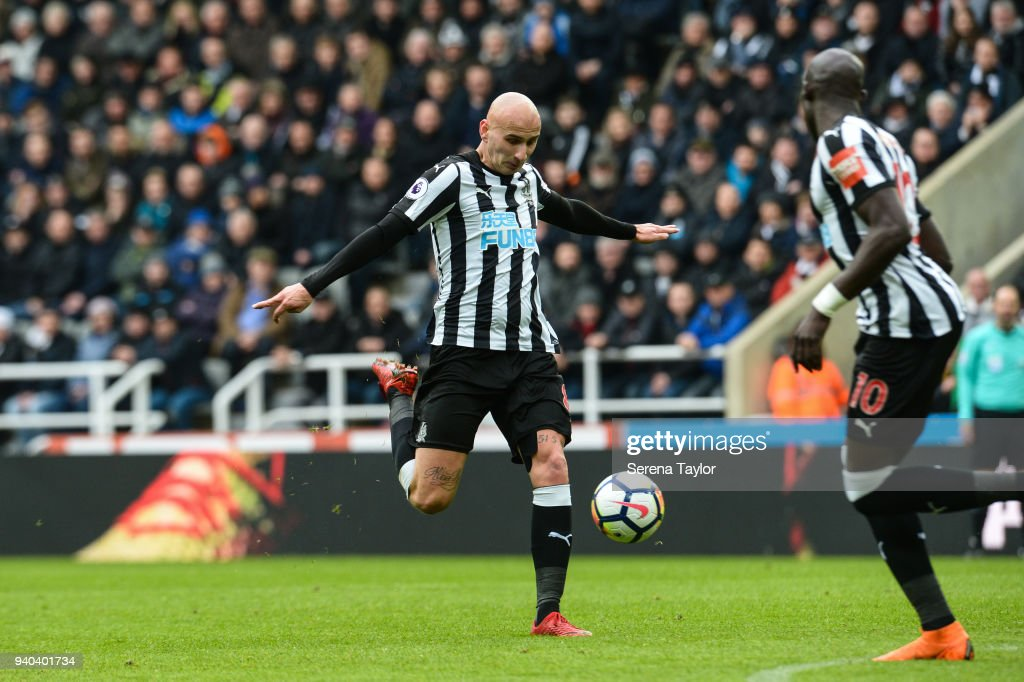 Jonjo Shelvey of Newcastle United (08) strikes the ball during the Premier League Match between Newcastle United and Huddersfield Town at St.James' Park on March 31, 2018, in Newcastle upon Tyne, England.