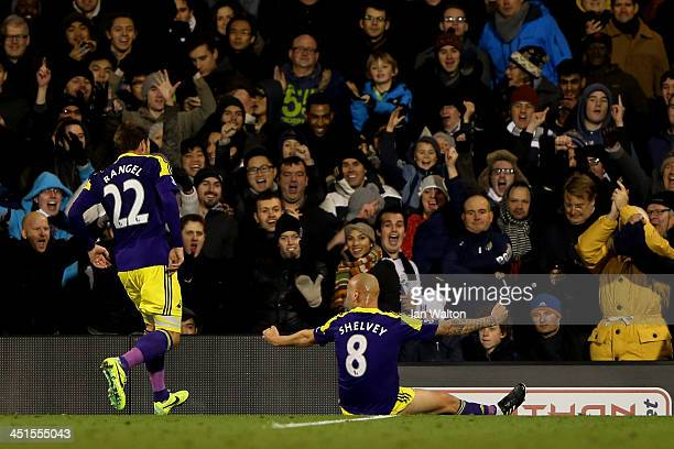 Jonjo Shelvey of Swansea celebrates scoring his team's second goal with Angel Rangel during the Barclays Premier League match between Fulham and...