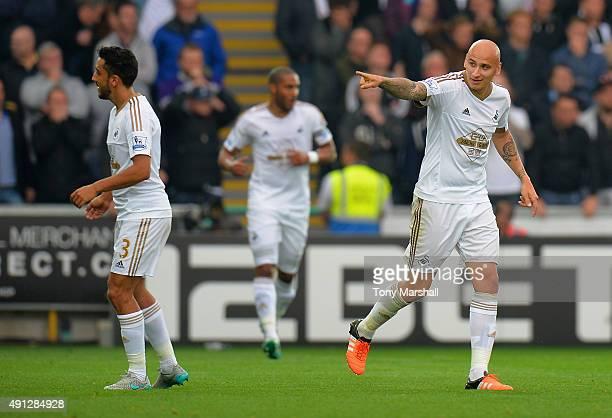 Jonjo Shelvey of Swansea City ceelbrates after Harry Kane of Tottenham Hotspur scores an own goal during the Barclays Premier League match between...