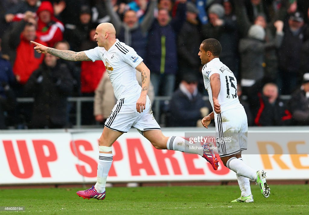 Jonjo Shelvey of Swansea City celebrates scoring their second goal with Wayne Routledge of Swansea City during the Barclays Premier League match between Swansea City and Manchester United at Liberty Stadium on February 21, 2015 in Swansea, Wales.