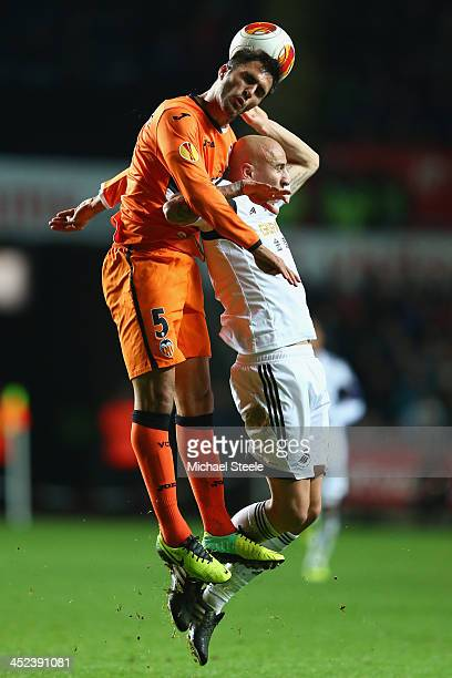 Jonjo Shelvey of Swansea City duels with Victor Ruiz of Valencia during the UEFA Europa League Group A match between Swansea City and Valencia at the...