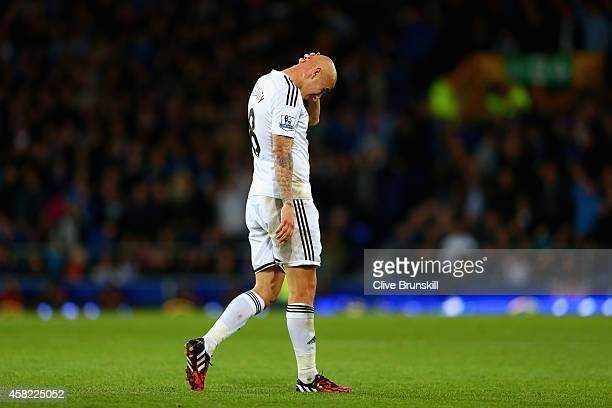 Jonjo Shelvey of Swansea City reacts after being sent off for a second yellow card during the Barclays Premier League match between Everton and...