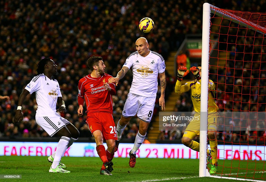 Jonjo Shelvey of Swansea City scores an own goal during the Barclays Premier League match between Liverpool and Swansea City at Anfield on December 29, 2014 in Liverpool, England.