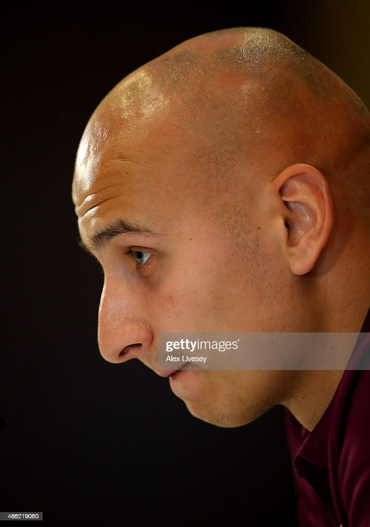 Jonjo Shelvey speaks to the media during the England press conference at St Georges Park on September 2, 2015 in Burton-upon-Trent, England.