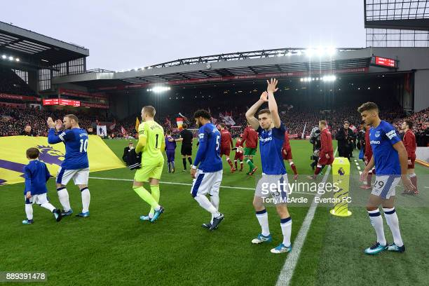 Jonjoe Kenny and team mates enter the pitch during the Premier League match between Liverpool and Everton at Anfield on December 10 2017 in Liverpool...
