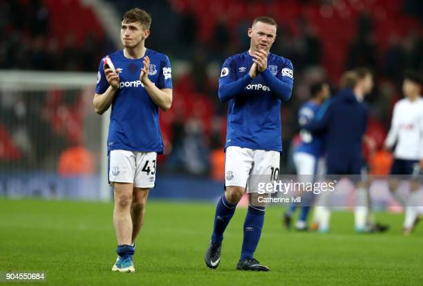 Jonjoe Kenny and Wayne Rooney of Everton applaud fans after the Premier League match between Tottenham Hotspur and Everton at Wembley Stadium on...