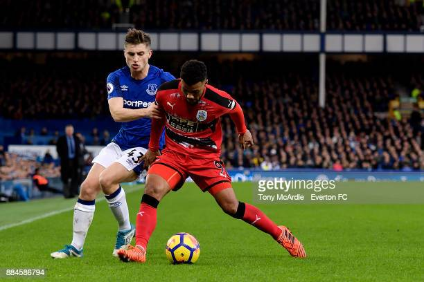 Jonjoe Kenny of Everton and Elias Kachunga challenge for the ball during the Premier League match between Everton and Huddersfield Town at Goodison...